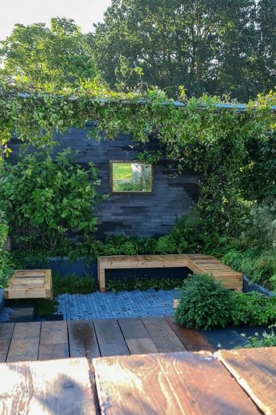 A pergola with a fence for privacy