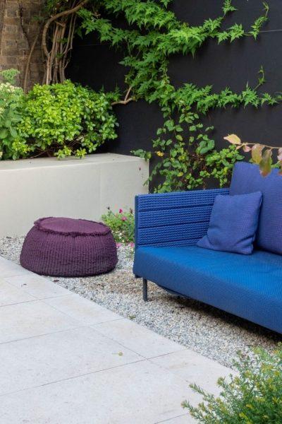 Garden design tips - paint walls and fences dark