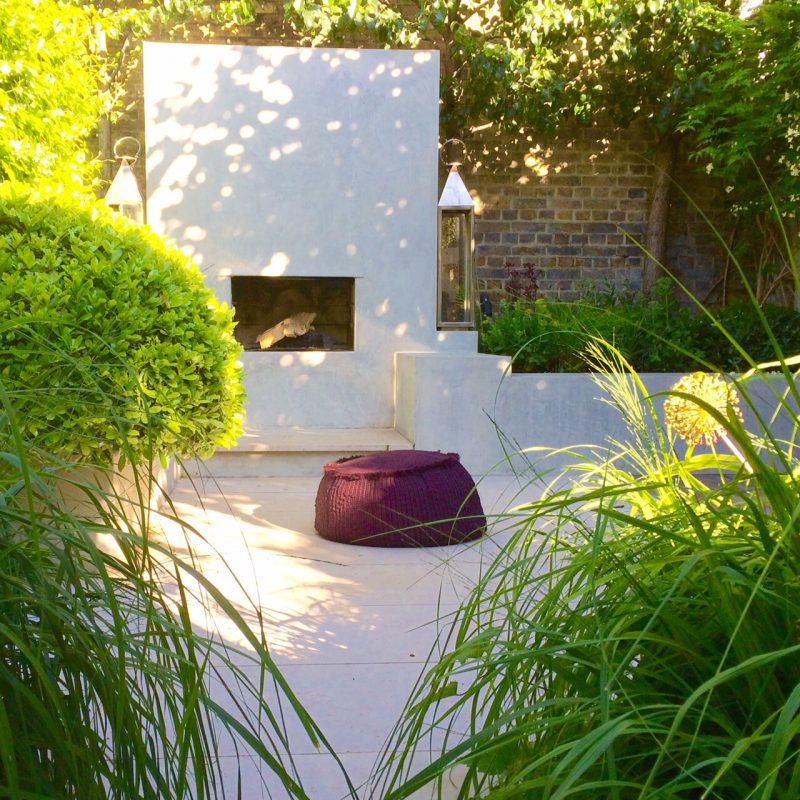 Use lush planting to frame a focal point in your garden