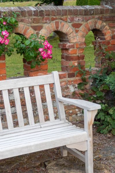 Wooden bench at Doddington Place Gardens