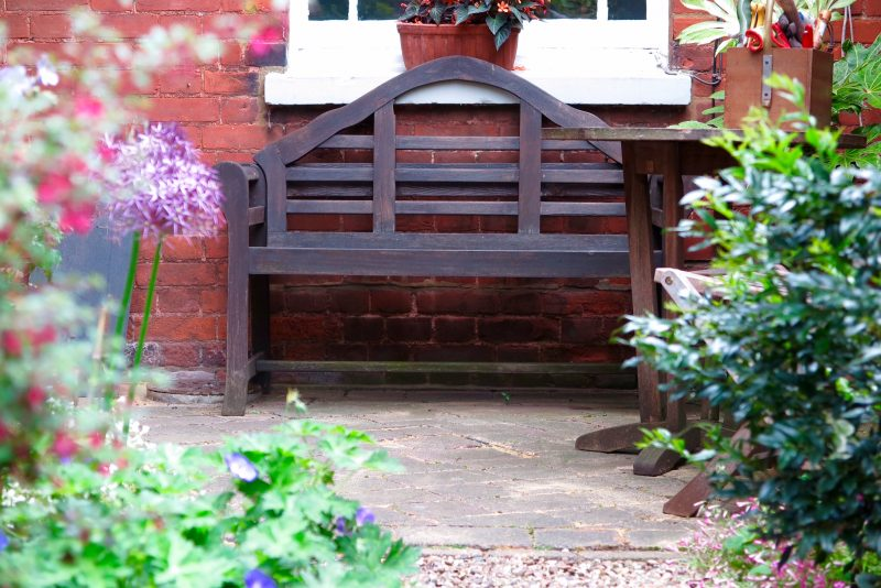 Pirvate seating spot in a narrow town garden