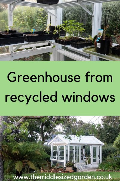 DIY greenhouse for a medium sized garden made from recycled windows
