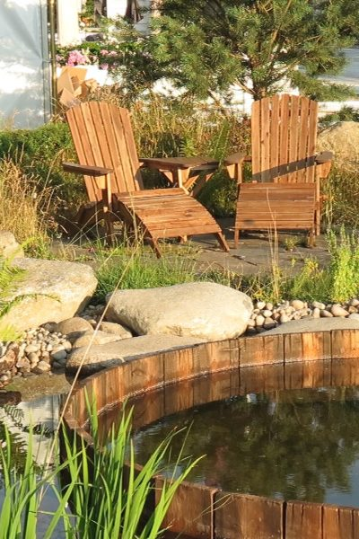 Create a seating area by your pond #backyard #gardendesign