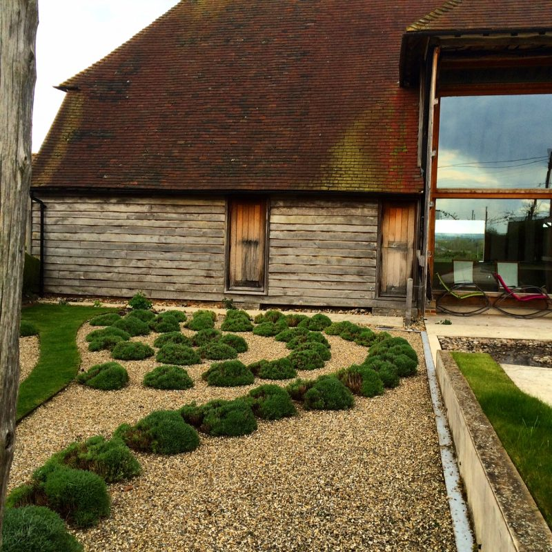 A contemporary country garden doesn't need a lawn - this area was once a working farmyard so gravel is both historically appropriate and contemporary