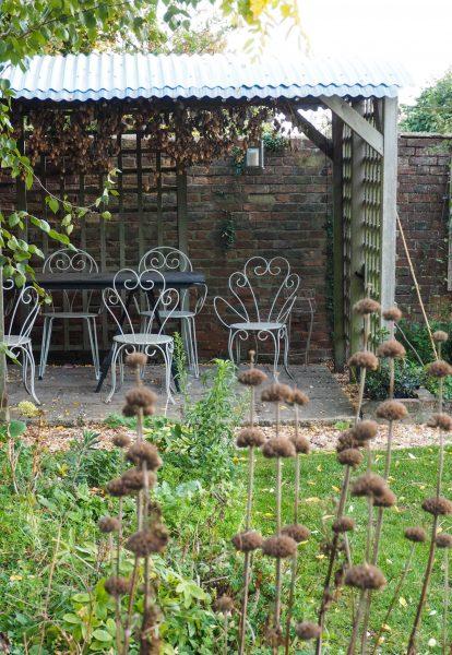 Save money on garden design by buying second hand garden furniture