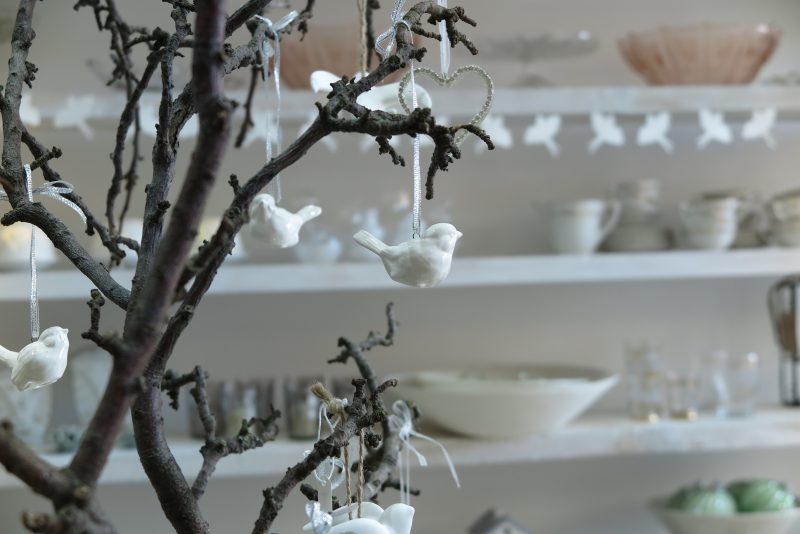 A garden branch as a Christmas table centrepiece