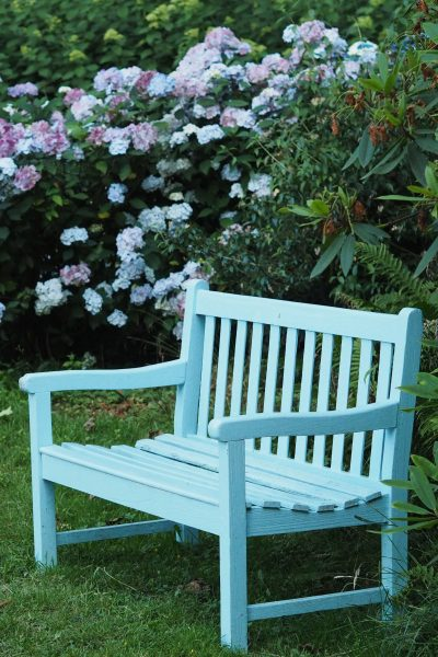 Blue bench at Doddington Place Gardens
