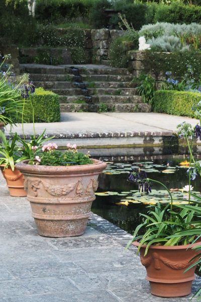 Plant pots around the edge of your garden pond #gardendesign #backyard