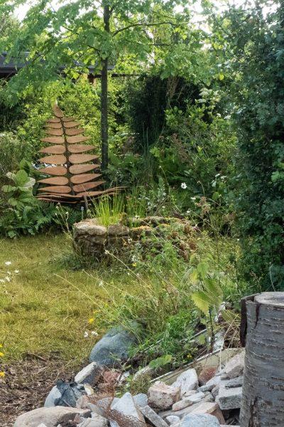 Sit in a wild garden.