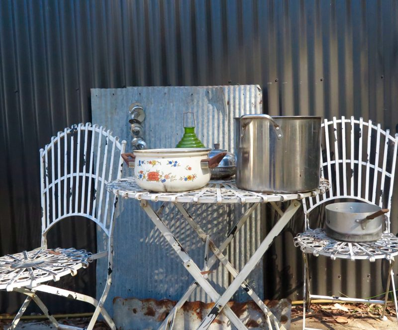 Vintage chairs and corrugated iron