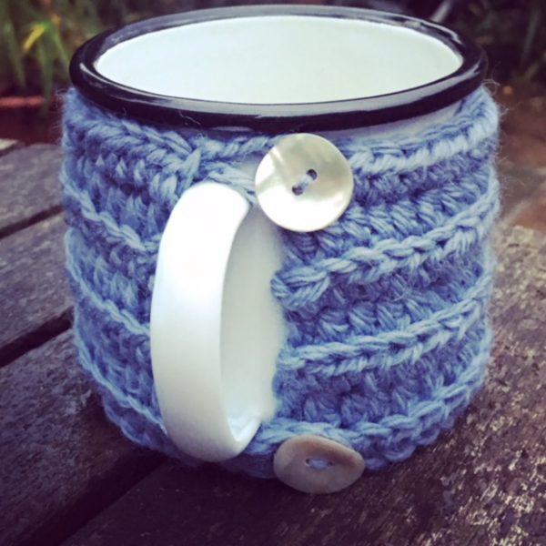 Hand-knitted mug cosy