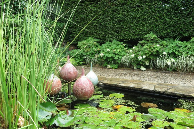 Garden ornaments in a pond at Cloudehill