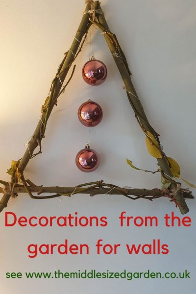 Use twigs to create a triangular wreath