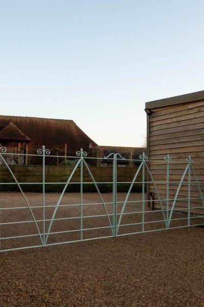 Bespoke driveway gates painted Blue Grey