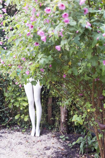 Garden with upcycled junk - here a shop mannequin is witty and pretty