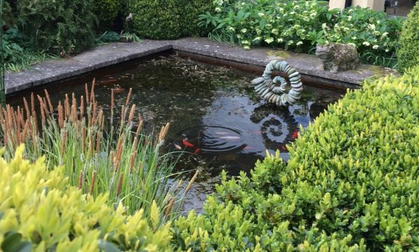 Add garden sculpture to a pond