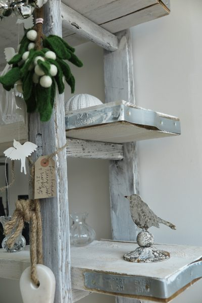 Shelves made of old ladders and scaffolding boards