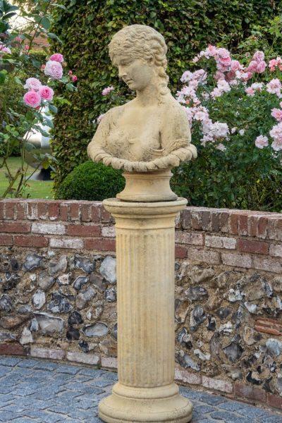 Classical bust garden sculpture