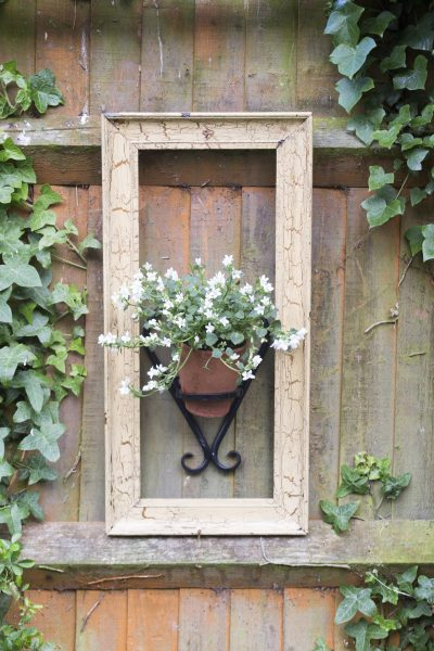 Vintage pots and picture frames used in gardens