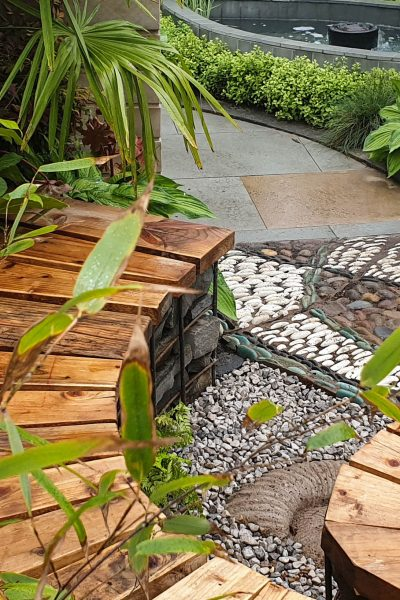 Try a curved path or bench.