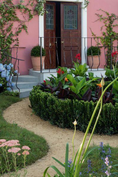 A curved garden path shapes the garden