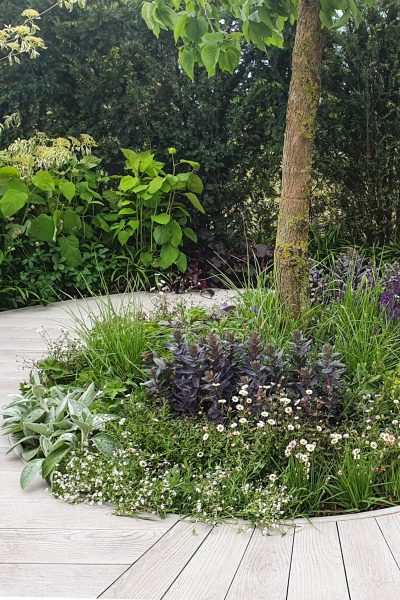 Try a circular bed in the middle of your garden