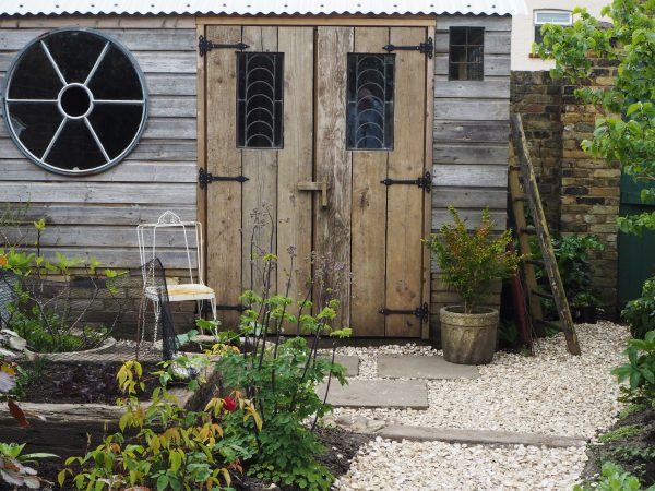 Posy's recycled shed and seashell path