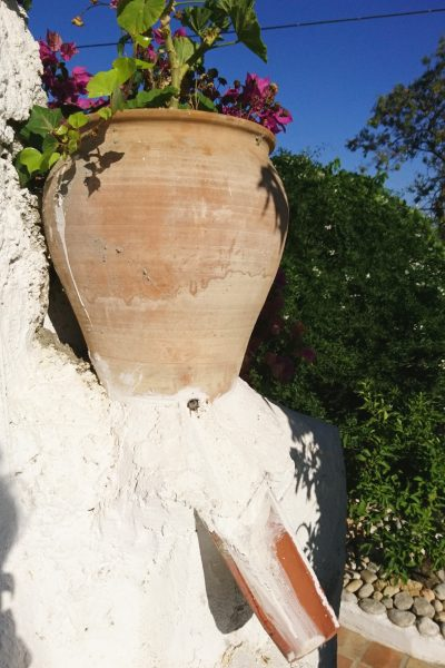 A clever trick for improving drainage and securing pots