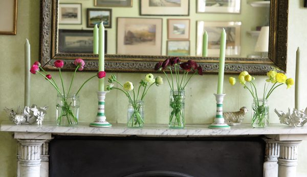 Jam jar flowers onto the mantelpiece