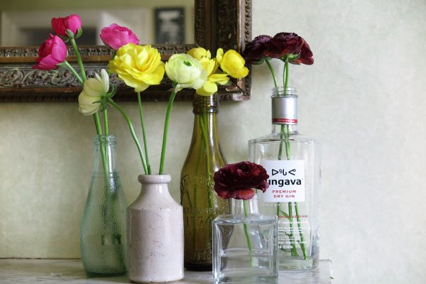 Recyle bottles of different sizes as vases