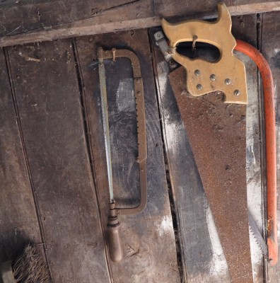 Rusty saws and spider's webs
