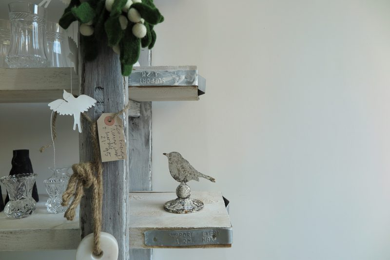 A Christmas theme of birds made of paper, iron or glass.