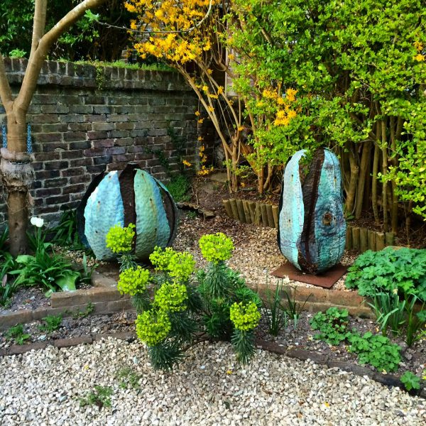 Use garden sculpture to add year-round colour to your garden
