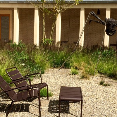 Think about how the colour of your garden furniture works with the planting