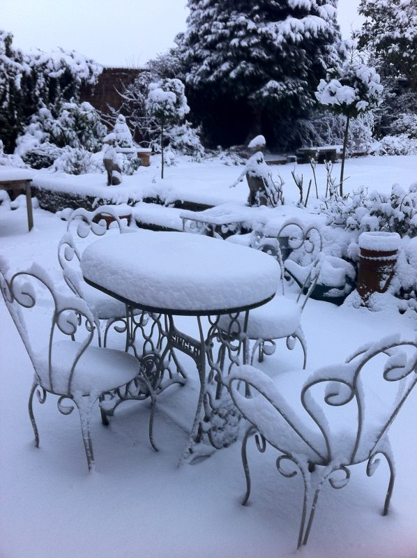 Snow on romantic garden furniture