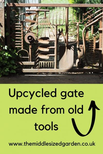 Upcycled garden gate made from old tools