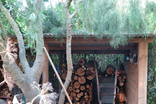 Woodshed with a corrugated iron roof