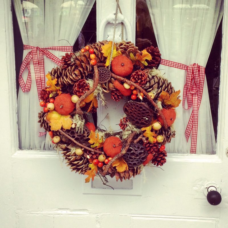 Festive Christmas wreath with fruit and pine cones