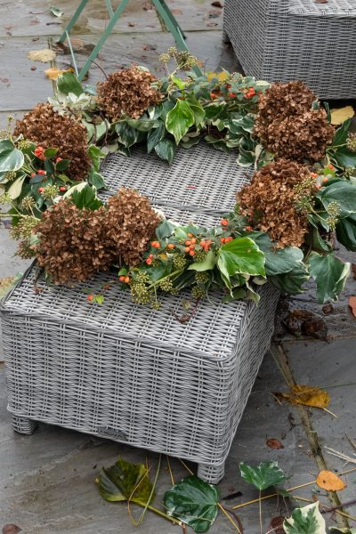 Add hydrangea heads and cotoneaster berries to the wreath