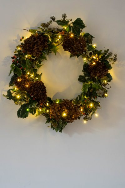 Buy fairy lights with a battery and timer for a wreath